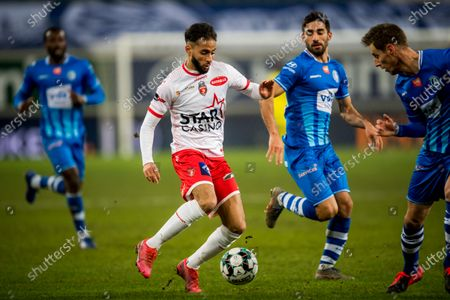Mouscron's Faraj Imad, Gent's Milad Mohammadi and Gent's Bruno Godeau fight for the ball during a soccer match between KAA Gent and Royal Excel Mouscron, Monday 15 February 2021 in Gent, on day 26 of the 'Jupiler Pro League' first division of the Belgian championship.