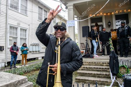 Stock Photo of Big Sam performs at a porch concert during Mardi Gras weekend on February 14, 2021 in New Orleans, LA. In the absence of traditional carnival festivities, New Orleanians have decorated their homes and businesses as floats.