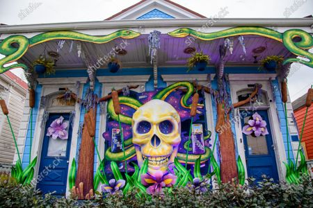 Stock Picture of A house is decorated in a Dr. John theme during Mardi Gras weekend on February 14, 2021 in New Orleans, LA. In the absence of traditional carnival festivities, New Orleanians have decorated their homes and businesses as floats.
