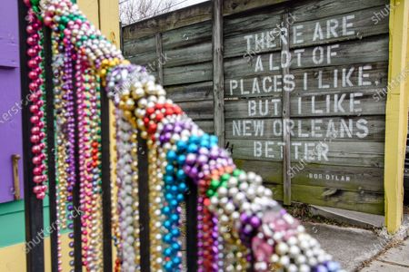 A Bob Dylan quote is seen on a fence on February 15, 2021 in New Orleans, LA. In the absence of traditional carnival festivities, New Orleanians have decorated their homes and businesses as floats.
