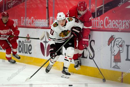 Chicago Blackhawks defenseman Ian Mitchell (51) checks Detroit Red Wings center Dylan Larkin (71) off the puck in the second period of an NHL hockey game, in Detroit