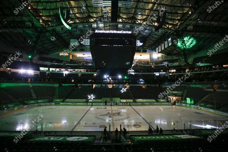The game lights and center screens are turned off at American Airlines Center which was to host the Nashville Predators and the Dallas Stars NHL hockey game, in Dallas. Dallas Mayor Eric Johnson requested that the teams not play tonight due to a shortage of electricity in the region