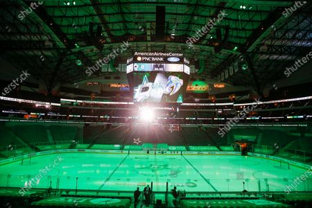 The game lights are turned off at American Airlines Center which was to host the Nashville Predators and the Dallas Stars NHL hockey game, in Dallas. Dallas Mayor Eric Johnson requested that the teams not play Monday due to a shortage of electricity in the region