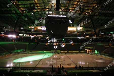 The game lights and center screens are turned off at American Airlines Center which was to host the Nashville Predators and the Dallas Stars NHL hockey game, in Dallas. Dallas Mayor Eric Johnson requested that the teams not play Monday due to a shortage of electricity in the region