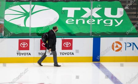 Game official leaves the rink at American Airlines Center which was to host the Nashville Predators and the Dallas Stars NHL hockey game, in Dallas. Dallas Mayor Eric Johnson requested that the teams not play Monday due to a shortage of electricity in the region