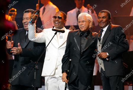 """Dominican salsa legend Johnny Pacheco, second right, acknowledges the audience as he is accompanied by colleagues Jose Alberto """"El Canario"""", right, Tito Nieves, left, and Sexappeal during the Casandra Awards ceremony in Santo Domingo, Dominican Republic. Pacheco has died on"""