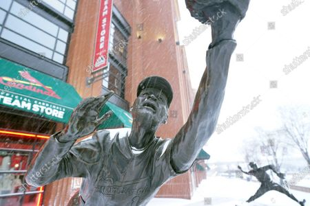 Snow falls on the statue of National Baseball Hall of Fame member Ozzie Smith, outside of Busch Stadium in St. Louis on Monday, February 15, 2021. St. Louis received about eight inches of snow as temperatures remained around zero for the day, with real feel temperatures about 16 degrees below zero.