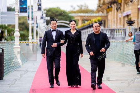 (L-R) Wang Jingchun, Yong Mei and Director Xiaoshuai Wang attends the 'Di Jiu Tian Chang (So Long, My Son)'  Premiere during the 67th San Sebastian Film Festival in San Sebastian, Spain, on September 23, 2019. (Photo by Manuel Romano/NurPhoto)