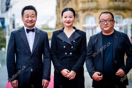 Stock Image of (L-R) Wang Jingchun, Yong Mei and Director Xiaoshuai Wang attends the 'Di Jiu Tian Chang (So Long, My Son)'  Premiere during the 67th San Sebastian Film Festival in San Sebastian, Spain, on September 23, 2019. (Photo by Manuel Romano/NurPhoto)