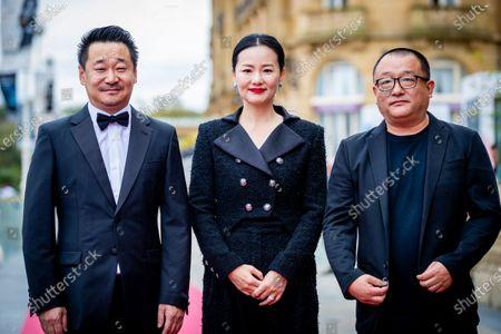 Stock Picture of (L-R) Wang Jingchun, Yong Mei and Director Xiaoshuai Wang attends the 'Di Jiu Tian Chang (So Long, My Son)'  Premiere during the 67th San Sebastian Film Festival in San Sebastian, Spain, on September 23, 2019. (Photo by Manuel Romano/NurPhoto)