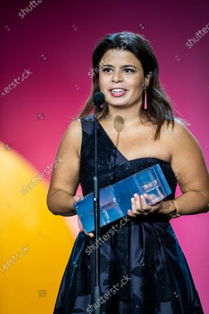 Gabriela Rodriguez accepts the Fispreci Award on behalf of Mexican director Alfonso Cuaron during the opening ceremony of the 67th San Sebastian Film Festival in the northern Spanish Basque city of San Sebastian on September 20, 2019. (Photo by Manuel Romano/NurPhoto)
