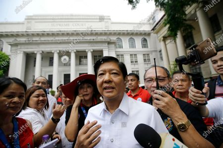 """Former Senator Ferdinand """"Bongbong"""" Marcos Jr. talks to reporters in front of the Philippine Supreme Court in Manila, Philippines The Philippine Supreme Court has dismissed an election protest by the son of the late dictator Ferdinand Marcos, thwarting his attempt to overturn his narrow defeat in the 2016 vice presidential election in what could have been a stunning political comeback. The 15-member court, which voted as an electoral tribunal, unanimously rejected the protest filed by Ferdinand Marcos Jr. after he lost to opposition leader Leni Robredo in the vice presidential race and claimed that he was cheated, court spokesperson Brian Hosaka said"""