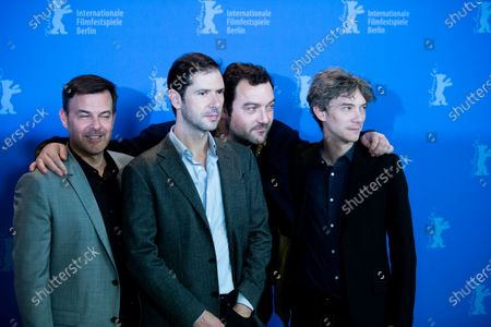 (L-R) Francois Ozon, Melvil Poupaud, Denis Menochet and Swann Arlaud attends the 'By the Grace of God' (Grace a Dieu) photocall at the 69th Berlinale International Film Festival Berlin on February 8, 2019, in Berlin, Germany. The Berlin film festival will be running from February 7 to 17, 2019. Nearly 400 movies from around the world will be presented, with 17 vying for the prestigious Golden Bear top prize.