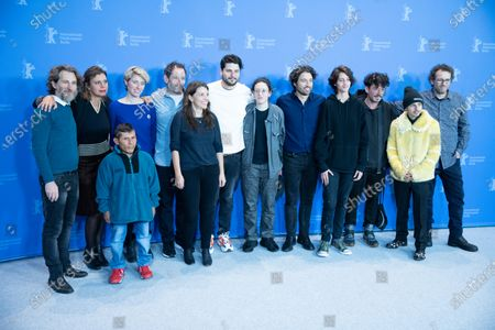 Stock Image of (L-R) Nicolas Avruj, Leontine Petit, Wilson Salazar, Katrin Pors, unknown, Cristina Landes, Santiago Zapata, Mica Levi, Alejandro Landes, Sofia Buenaventura, Alexis Dos Santos, Moises Arias and Fernando Epstein attends the 'Monos' Photocall at the 69th Berlinale International Film Festival Berlin on February 10, 2019, in Berlin, Germany. The Berlin film festival will be running from February 7 to 17, 2019. Nearly 400 movies from around the world will be presented, with 17 vying for the prestigious Golden Bear top prize.