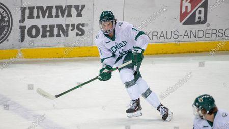 Stock Picture of Bemidji State forward Eric Martin (11) skates against Northern Michigan during an NCAA hockey game, in Bemidji, Minn