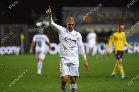 Tranmere Rovers forward James Vaughan (9) raises his hand in triumph at the final whistle during the EFL Trophy match between Oxford United and Tranmere Rovers at the Kassam Stadium, Oxford