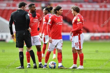 Stock Picture of Cafu (18), Filip Krovinovic (27) and Luke Freeman of (15) Nottingham Forest discuss tactics ahead of a Forest free-kick during the Sky Bet Championship match between Nottingham Forest and Bournemouth at the City Ground, Nottingham on Saturday 13th February 2021.  (Photo by Jon Hobley/MI News/NurPhoto)