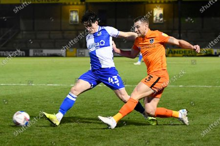 Lee Brown (3) of Portsmouth crosses the ball as George Williams (43) of Bristol Rovers challenges during the EFL Sky Bet League 1 match between Bristol Rovers and Portsmouth at the Memorial Stadium, Bristol