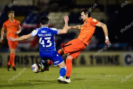 Charlie Daniels (21) of Portsmouth battles for possession with George Williams (43) of Bristol Rovers during the EFL Sky Bet League 1 match between Bristol Rovers and Portsmouth at the Memorial Stadium, Bristol