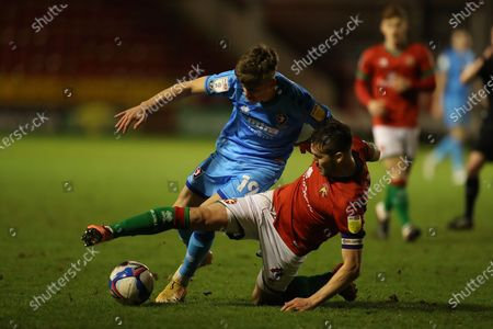 Stock Image of George Lloyd of Cheltenham Town  and Matthew Sadler of Walsall   fight over ball during the EFL Sky Bet League 2 match between Walsall and Cheltenham Town at the Banks's Stadium, Walsall