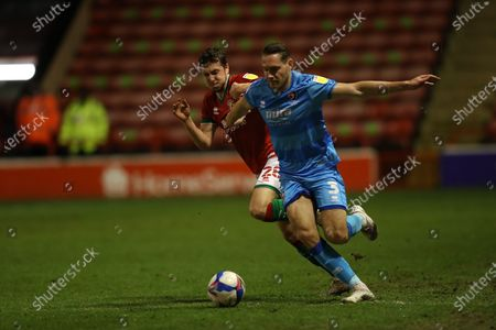 Ellis Chapman of Cheltenham Town  runs down wing pursued by Frank Vincent of Walsall  during the EFL Sky Bet League 2 match between Walsall and Cheltenham Town at the Banks's Stadium, Walsall