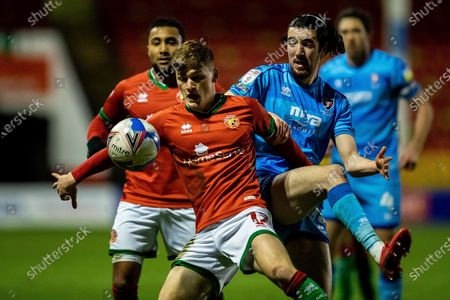 Alfie Bates of Walsall heads the ball against George Lloyd of Cheltenham Town   during the EFL Sky Bet League 2 match between Walsall and Cheltenham Town at the Banks's Stadium, Walsall