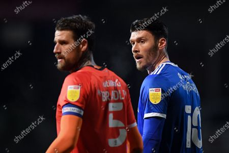Kieffer Moore of Cardiff City with Sonny Bradley of Luton Town