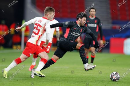 Liverpool's Alex Oxlade-Chamberlain, right, challenges for the ball with Leipzig's Daniel Olmo during the Champions League round of 16, first leg, soccer match between RB Leipzig and Liverpool at the Ferenc Puskas stadium in Budapest, Hungary