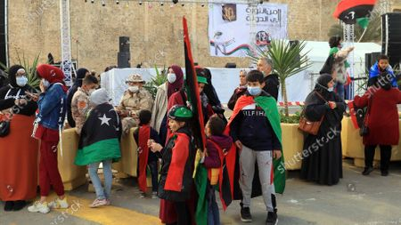 Libyan people attend the festivities to commemorate  the 10th anniversary of the uprising against former leader Muammar Gaddafi, in Tripoli, Libya, 16 February 2021. On 17 February 2011, a rebellion against the 42-year-long rule of the Libyan leader, Colonel Muammar Gaddafi took place. The protests began peacefully but soon escalated into a violent confrontation, giving the Libyan revolt a more bloody character than those in Tunisia and Egypt.  Gaddafi was captured alive on 20 October 2011 by National Transitional Council-backed fighters in Sirte and then killed along with his son, Moutassem. After years of political and security turmoil, a UN-led libya forum voted on the formation of a new government on 05 February 2021, the country is due to hold presidential and parliamentary election in December 2021.