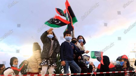 Children holding Libyan flags a day ahead of commemorations of the 10th anniversary of the uprising against former leader Muammar Gaddafi, in Tripoli, Libya, 16 February 2021. On 17 February 2011, a rebellion against the 42-year-long rule of the Libyan leader, Colonel Muammar Gaddafi took place. The protests began peacefully but soon escalated into a violent confrontation, giving the Libyan revolt a more bloody character than those in Tunisia and Egypt.  Gaddafi was captured alive on 20 October 2011 by National Transitional Council-backed fighters in Sirte and then killed along with his son, Moutassem. After years of political and security turmoil, a UN-led libya forum voted on the formation of a new government on 05 February 2021, the country is due to hold presidential and parliamentary election in December 2021.