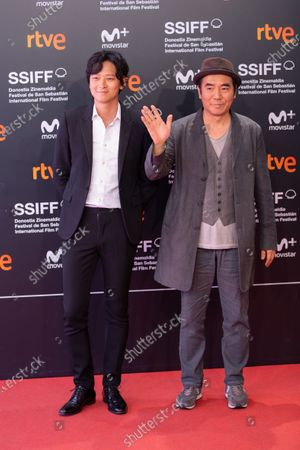 Stock Image of Director Jee-woon Kim (R) and actor Gang Dong-Won attends the 'Illang: The Wolf Brigade' Premiere during the 66th San Sebastian International Film Festival on September 26, 2018 in San Sebastian, Spain.