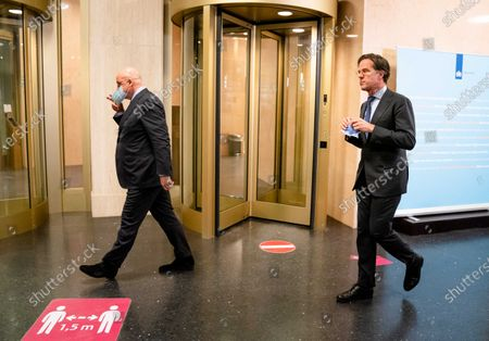 Outgoing minister Ferdinand Grapperhaus (L, Justice and Security) and Prime Minister Mark Rutte prior to the response to the verdict in The Hague, The Netherlands, 16 February 2021. The court of appeal in The Hague has suspended the court's decision in summary proceedings about the lifting of the curfew upon the request of the Government, which has appealed against the verdict. The curfew will remain in effect for the time being.