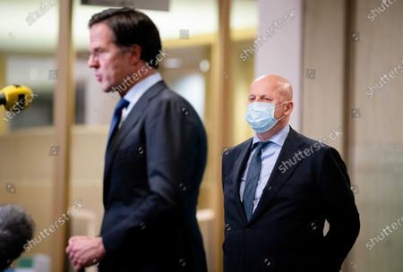 Outgoing minister Ferdinand Grapperhaus (R, Justice and Security) and Prime Minister Mark Rutte during the response to the verdict in The Hague, The Netherlands, 16 February 2021. The court of appeal in The Hague has suspended the court's decision in summary proceedings about the lifting of the curfew upon the request of the Government, which has appealed against the verdict. The curfew will remain in effect for the time being.