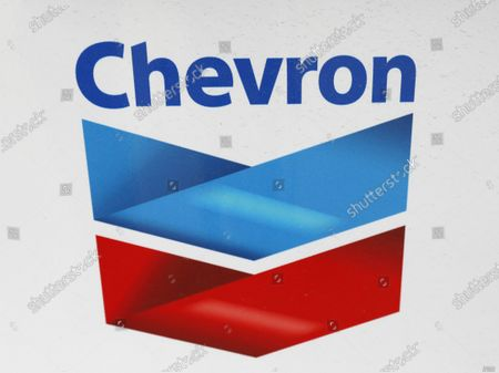 A Chevron corporate logo is displayed on a gas pump in Flowood, Miss. Warren Buffett's company made major new investments in Verizon and Chevron and again trimmed its huge stake in Apple while making several other adjustments to its stock portfolio last year. Berkshire Hathaway said in a regulatory filing Tuesday, Feb. 16, 2021, that it bought $8.6 billion worth of Verizon stock and picked up $4 billion worth of Chevron shares over the last six months of 2020