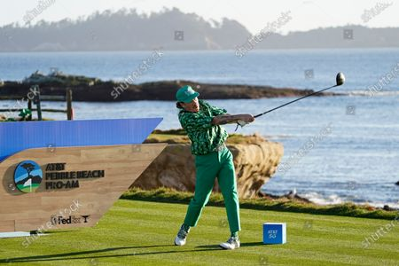 Macklemore hits from the 18th tee during the charity challenge event of the AT&T Pebble Beach Pro-Am golf tournament, in Pebble Beach, Calif