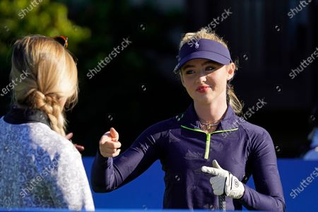 Kathryn Newton points to Kira K. Dixon during the charity challenge event of the AT&T Pebble Beach Pro-Am golf tournament, in Pebble Beach, Calif