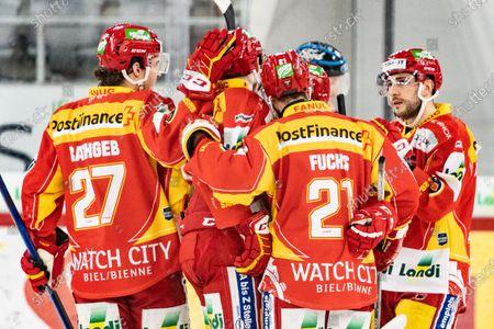 Stock Photo of Lausanne HC, #27 Yannick Rathgeb (Biel), #21 Jason Fuchs (Biel), #67 Konstantin Komarek (Biel) celebrates the 2-1