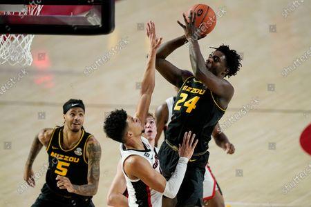 Missouri forward Kobe Brown (24) shoots against Georgia forward Toumani Camara during the first half of an NCAA college basketball game, in Athens, Ga