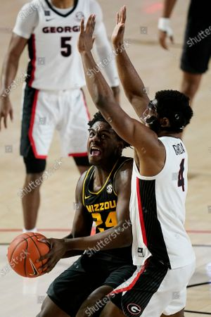 Missouri forward Kobe Brown (24) shoots against Georgia forward Andrew Garcia (4) during the first half of an NCAA college basketball game, in Athens, Ga