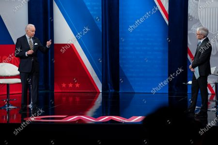 Anderson Cooper listens as President Joe Biden answers questions during a televised town hall event at Pabst Theater, in Milwaukee