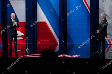 Stock Image of Anderson Cooper listens as President Joe Biden speaks during a televised town hall event at Pabst Theater, in Milwaukee
