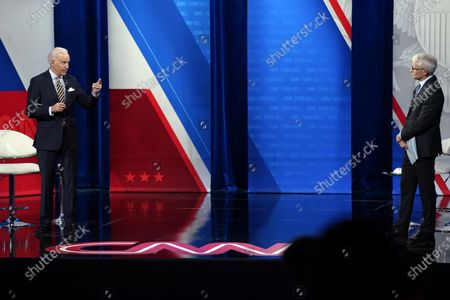 President Joe Biden speaks as Anderson Cooper listens during a televised town hall event at Pabst Theater, in Milwaukee