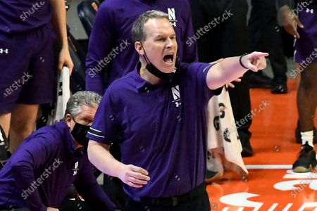 Northwestern coach Chris Collins gestures during the first half of the team's NCAA college basketball game against Illinois, in Champaign, Ill