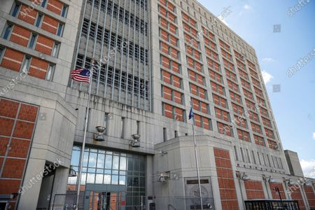 In this, photo, fencing protects the main entrance of the Metropolitan Detention Center where British socialite Ghislaine Maxwell is being held in the Brooklyn borough of New York. Jeffrey Epstein's former girlfriend, Maxwell, claims a guard physically abused her at the jail. Maxwell's lawyer told a judge in a letter Tuesday, Feb. 16, 2021, that Maxwell who has pleaded not guilty to recruiting girls for the financier to sexually abuse in the 1990s is losing weight, hair and her ability to concentrate and prepare for trial, and was physically abused during a recent pat down search