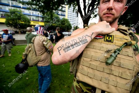"""Joseph Oakman, a member of the Proud Boys, wears body armor during an """"End Domestic Terrorism"""" rally in Portland, Ore. Alex DiBranco, executive director of the Institute for Research on Male Supremacism, said there are differences among Proud Boys chapters over whether to embrace women as Proud Girls or not, even as the group as a whole has become more hostile to women's auxiliaries over the past couple of years"""