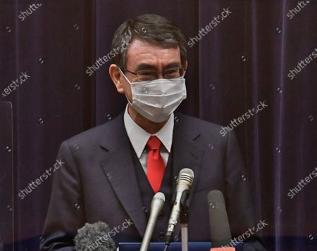 Japan's Administrative Reform Minister Taro Kono, who is also in charge of COVID-19 vaccines attends the press conference in Tokyo, Japan.