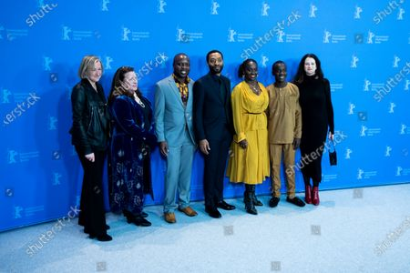 Stock Photo of (L-R) Producer Gail Egan, casting director Alexa Fogel, author William Kamkwamba, director Chiwetel Ejiofor, actress Aissa Maiga, actor Maxwell Simba and producer Andrea Calderwood attends the photocall for the Netflix film 'The Boy Who Harnessed The Wind' during the 69th Berlinale International Film Festival Berlin at Grand Hyatt Hotel on February 12, 2019 in Berlin, Germany.  (Photo by Manuel Romano/NurPhoto)