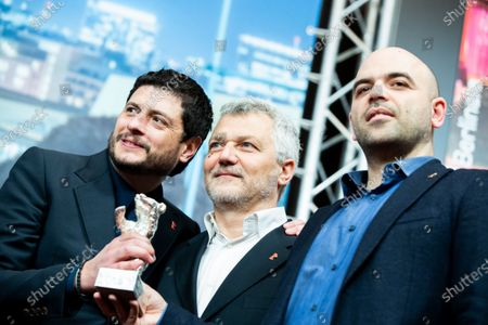 (L-R) Claudio Giovannesi, Maurizio Braucci and Roberto Saviano, winner of the Silver Bear for Best Screenplay attends the press conference after the closing ceremony of the 69th Berlinale International Film Festival Berlin at Berlinale Palace on February 16, 2019 in Berlin, Germany. (Photo by Manuel Romano/NurPhoto)
