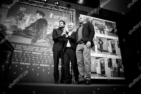 (EDITOR'S NOTE: Image was converted to black and white) (L-R) Claudio Giovannesi, Maurizio Braucci and Roberto Saviano, winner of the Silver Bear for Best Screenplay attends the press conference after the closing ceremony of the 69th Berlinale International Film Festival Berlin at Berlinale Palace on February 16, 2019 in Berlin, Germany. (Photo by Manuel Romano/NurPhoto)