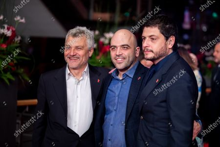 Maurizio Braucci, Claudio Giovannesi and Roberto Saviano arrives for the closing ceremony of the 69th Berlinale International Film Festival Berlin at Berlinale Palace on February 16, 2019 in Berlin, Germany.  (Photo by Manuel Romano/NurPhoto)